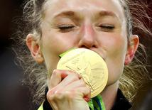 2016 Rio Olympics - Trampoline Gymnastics - Victory Ceremony - Women's Victory Ceremony - Rio Olympic Arena - Rio de Janeiro, Brazil - 12/08/2016. Rosannagh MacLennan (CAN) of Canada kisses her gold medal after winning the women's trampoline final.  REUTERS/Mike Blake  TPX IMAGES OF THE DAY.