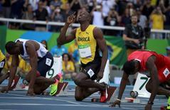 2016 Rio Olympics - Athletics - Preliminary - Men's 100m Round 1 - Olympic Stadium - Rio de Janeiro, Brazil - 13/08/2016. Usain Bolt (JAM) of Jamaic reacts  REUTERS/Phil Noble