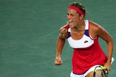 2016 Rio Olympics - Tennis - Final - Women's Singles Gold Medal Match - Olympic Tennis Centre - Rio de Janeiro, Brazil - 13/08/2016. Monica Puig (PUR) of Puerto Rico reacts during match against Angelique Kerber (GER) of Germany.   REUTERS/Kevin Lamarque