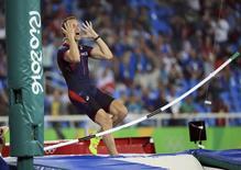 2016 Rio Olympics - Athletics - Final - Men's Pole Vault Final - Olympic Stadium - Rio de Janeiro, Brazil - 15/08/2016. Renaud Lavillenie (FRA) of France reacts. REUTERS/Dominic Ebenbichler