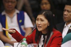 Maia Santos Deguito, a branch manager of the Rizal Commercial Banking Corp (RCBC) gestures as she testifies during a Senate hearing of money laundering involving $81 million stolen from  Bangladesh's central bank, at the Philippine Senate in Manila April 19, 2016. REUTERS/Erik De Castro