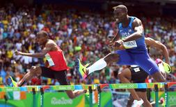2016 Rio Olympics - Athletics - Final - Men's 400m Hurdles Final - Olympic Stadium - Rio de Janeiro, Brazil - 18/08/2016. Kerron Clement (USA) of USA runs to win gold ahead of Boniface Mucheru (KEN) of Kenya who won silver.    REUTERS/Dominic Ebenbichler