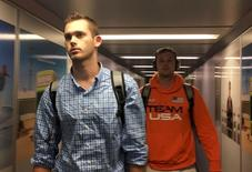 U.S. Olympic swimmers Jack Conger and Gunnar Bentz arrive at the Miami international airport from Rio de Janeiro a day after Brazilian police detained their passports and questioned them, in Miami August 19, 2016. REUTERS/Cassandra Garrison