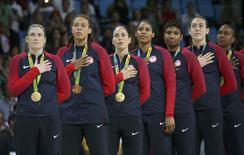 2016 Rio Olympics - Basketball - Final - Women's Gold Medal Game USA v Spain - Carioca Arena 1 - Rio de Janeiro, Brazil - 20/8/2016.  Lindsay Whalen (USA) of USA, Seimone Augustus (USA) of USA, Sue Bird (USA) of USA Maya Moore (USA) of USA, Angel McCoughtry (USA) of USA, Breanna Stewart (USA) of USA and Tamika Catchings (USA) of USA (L to R) stand for the playing of the U.S. National Anthem during the medal presentation ceremony for the women's basketball top finishers.    REUTERS/Shannon Stapleton