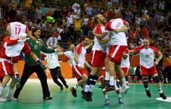 2016 Rio Olympics - Handball - Final - Men's Gold Medal Game Denmark v France - Future Arena - Rio de Janeiro, Brazil - 21/08/2016. Team Denmark players celebrate victory. REUTERS/Kai Pfaffenbach