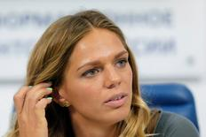 Russia's Olympic medalist Yulia Efimova, who won silver medals for Women's Swimming 100m and 200m Breaststroke, attends a news conference in Moscow, Russia August 24, 2016. REUTERS/Maxim Zmeyev