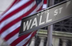 A Wall Street sign is pictured outside the New York Stock Exchange in New York, October 28, 2013.  REUTERS/Carlo Allegri  (UNITED STATES - Tags: BUSINESS) - RTX14RP0