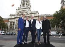"""Victoria and Albert Museum staff, Martin Roth (L), Tim Reeve (C) and Victoria Broakes (2nd R) pose with promoter Michael Cohl (R) and Nick Mason of Pink Floyd, to promote """"The Pink Floyd Exhibition: Their Mortal Remains"""", which will open in May 2017, in London, Britain August 31, 2016.  REUTERS/Peter Nicholls"""