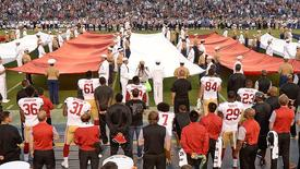 Sep 1, 2016; San Diego, CA, USA;  San Francisco 49ers quarterback Colin Kaepernick (7, bottom middle) kneels during the national anthem before the game against the San Diego Chargers at Qualcomm Stadium. Mandatory Credit: Jake Roth-USA TODAY Sports
