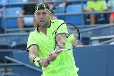 Aug 31, 2016; New York, NY, USA; Jack Sock of the United States returns a shot to Mischa Zverev of Germany on day three of the U.S. Open tennis tournament at USTA Billie Jean King National Tennis Center. Mandatory Credit: Anthony Gruppuso-USA TODAY Sports
