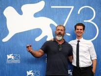 """Director and actor Mel Gibson (L) and actor Andrew Garfield attend the photocall for the movie """"Hacksaw Ridge"""" at the 73rd Venice Film Festival in Venice, Italy September 4, 2016. REUTERS/Alessandro Bianchi"""