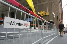 A pedestrian walks past a closed street in downtown Montreal August 24, 2007.  REUTERS/Shaun Best