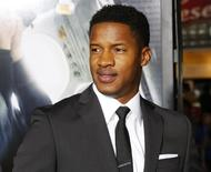 """Actor Nate Parker poses at the premiere of his new film """"Non-Stop"""" in Los Angeles, California, U.S. February 24, 2014. REUTERS/Fred Prouser/File Photo"""