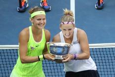 Sep 11, 2016; New York, NY, USA; Bethanie Mattek-Sands of the United States and Lucie Safarova of the Czech Republic with the championship trophy after the win against Caroline Garcia and Kristina Mladenovic of France in the championship match on day fourteen of the 2016 U.S. Open tennis tournament at USTA Billie Jean King National Tennis Center. Mandatory Credit: Anthony Gruppuso-USA TODAY Sports