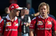 Ferrari's Sebastian Vettel of Germany (L) enters the Marina Bay Circuit ahead of the Singapore F1 Grand Prix Night Race in Singapore, September 15, 2016. REUTERS/Jeremy Lee