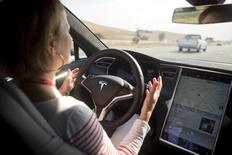 New autopilot features are demonstrated in a Tesla Model S during a Tesla event in Palo Alto, California. REUTERS/Beck Diefenbach