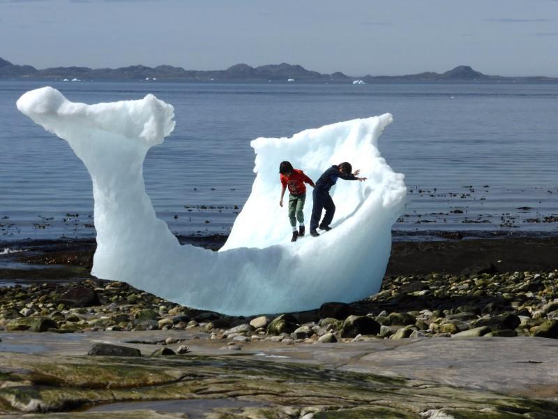 At ground zero of warming, Greenland seeks to unlock frozen assets