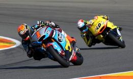 Kalex Moto2 rider Tito Rabat (L) of Spain rides his bike ahead of Kalex rider Alex Rins of Spain during the Valencia Motorcycle Grand Prix at the Ricardo Tormo racetrack in Cheste, near Valencia, November 8, 2015. Rabat won the race and Rins was second. REUTERS/Heino Kalis