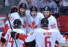 Sep 20, 2016; Toronto, Ontario, Canada;  Team Canada forward Matt Duchene (9) celebrates with team mates Joe Thornton (97), Ryan O'Reilly (90) Shea Weber (6) and Marc-Edouard Vlasic (44) after scoring against Team USA during preliminary round play in the 2016 World Cup of Hockey at Air Canada Centre. Dan Hamilton-USA TODAY Sports