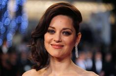 """FILE PHOTO --  Cast member Marion Cotillard poses on the red carpet as they arrive for the screening of the film """"Juste la fin du monde"""" (It s Only the End of the World) in competition at the 69th Cannes Film Festival in Cannes, France, May 19, 2016.  REUTERS/Regis Duvignau/File Photo"""