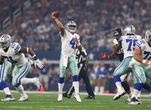 Sep 25, 2016; Arlington, TX, USA; Dallas Cowboys quarterback Dak Prescott (4) throws in the pocket against the Chicago Bears at AT&T Stadium. Mandatory Credit: Matthew Emmons-USA TODAY Sports