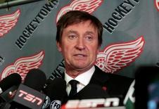 Retired National Hockey League (NHL) player and Hall of Famer Wayne Gretzky talks with the media during the public visitation of the late former NHL player Gordie Howe at Joe Louis Arena in Detroit, Michigan, U.S. June 14, 2016. REUTERS/Rebecca Cook