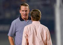 Sep 10, 2016; Bristol, TN, USA;  Tennessee Volunteers former quarterback Peyton Manning speaks with Tennessee governor Bill Haslam before the game against the Virginia Tech Hokies at Bristol Motor Speedway. Mandatory Credit: Randy Sartin-USA TODAY Sports
