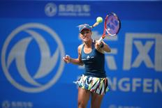 Tennis - Wuhan Open Women's Singles second round - Wuhan, Hubei Province, China - 27/9/16. Angelique Kerber of Germany is seen playing against Kristina Mladenovic of France. REUTERS/Stringer ATTENTION EDITORS - THIS IMAGE WAS PROVIDED BY A THIRD PARTY. EDITORIAL USE ONLY. CHINA OUT. NO COMMERCIAL OR EDITORIAL SALES IN CHINA.