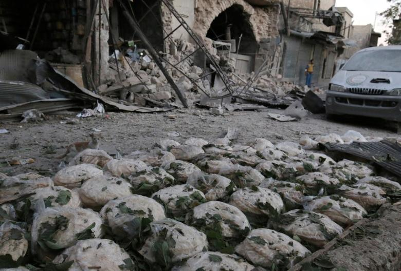 Stacks of bread are seen at a damaged site after an airstrike in the rebel-held Bab al-Maqam neighborhood of Aleppo, Syria. REUTERS/Abdalrhman Ismail