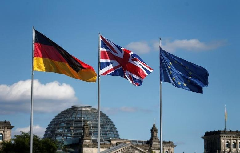 German, British and European Union flags fly in front of the Reichstag building in Berlin, Germany July 20, 2016. REUTERS/Hannibal Hanschke/File Photo