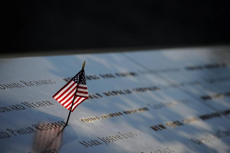 A lone flag sits at the North Pool of the National September 11 Memorial, ahead of the 15th anniversary of the attacks in Manhattan, New York, September 10, 2016.  REUTERS/Mark Kauzlarich