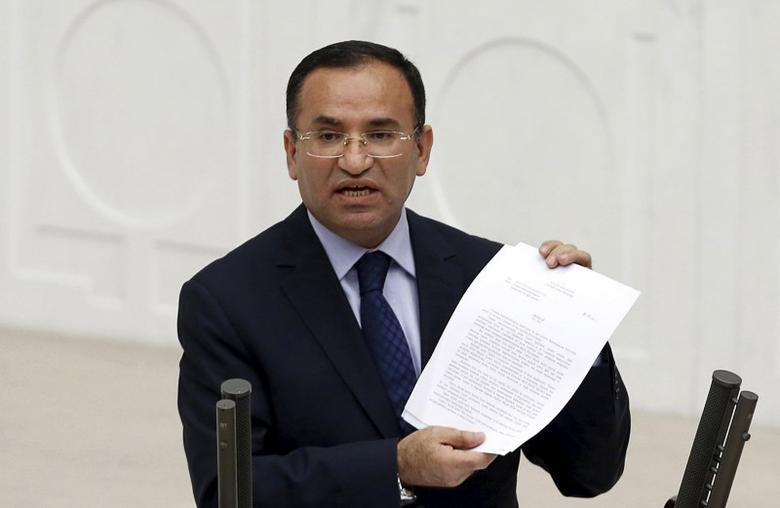 Justice Minister Bekir Bozdag addresses the Turkish Parliament during a debate in Ankara in this March 19, 2014 file photo. REUTERS/Umit Bektas/Files