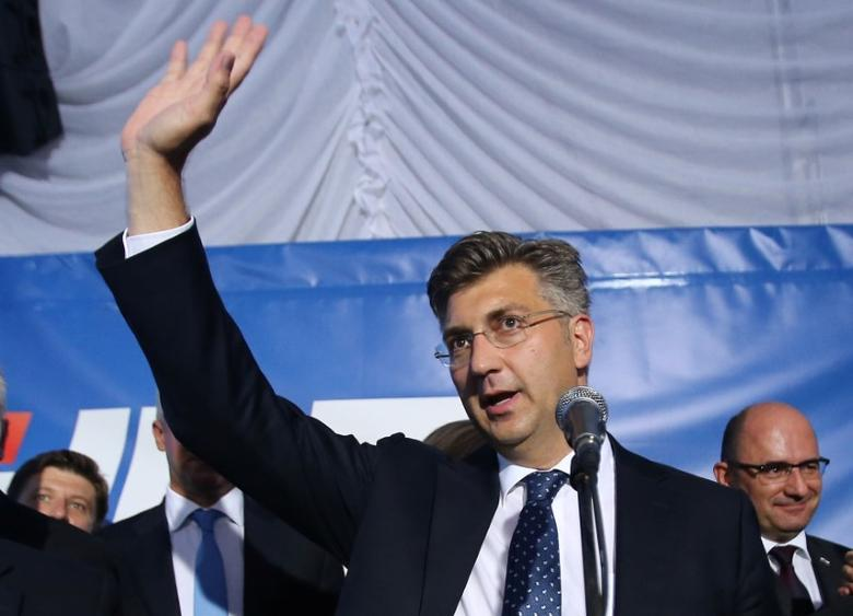 Andrej Plenkovic, president of the Croatian Democratic Union (HDZ), reacts during a speech after exit polls in Zagreb, Croatia, September 11, 2016. REUTERS/Antonio Bronic