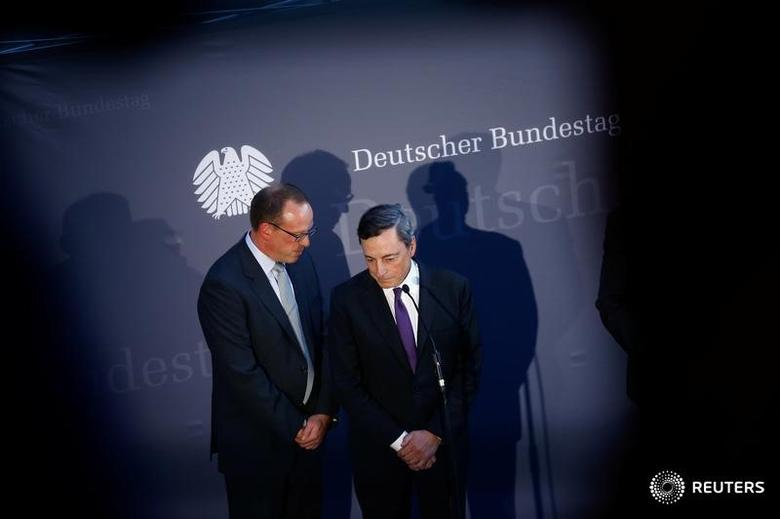 European Central Bank (ECB) President Mario Draghi and an interpreter attend a news conference after a meeting with German lawmakers in Berlin, Germany, September 28, 2016.    REUTERS/Axel Schmidt/Files
