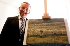 Director of Amsterdam's Van Gogh Museum Axel Ruger poses next to a painting by the Dutch artist Vincent Van Gogh, that was stolen in Amsterdam 14 years ago, during a news conference in Naples September 30, 2016. REUTERS/Ciro De Luca