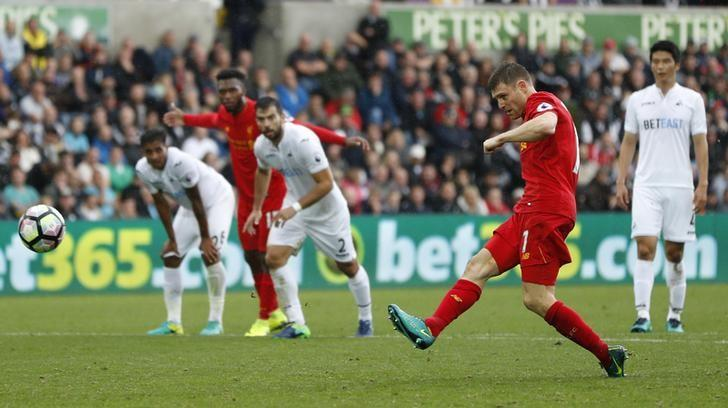 Britain Soccer Football - Swansea City v Liverpool - Premier League - Liberty Stadium - 1/10/16Liverpool's James Milner scores their second goal from the penalty spot Action Images via Reuters / John SibleyLivepic