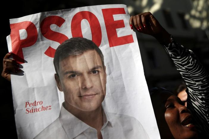 A supporter of Spain's Socialist party (PSOE) leader Pedro Sanchez holds his poster outside the party's headquarters during the party's assembly meeting in Madrid, Spain, October 1, 2016. REUTERS/Susana Vera