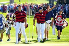 Oct 1, 2016; Chaska, MN, USA;  Jordan Spieth of the United States and  Patrick Reed of the United States celebrate on the sixth green during the afternoon four-ball matches in the 41st Ryder Cup at Hazeltine National Golf Club. Mandatory Credit: John David Mercer-USA TODAY Sports