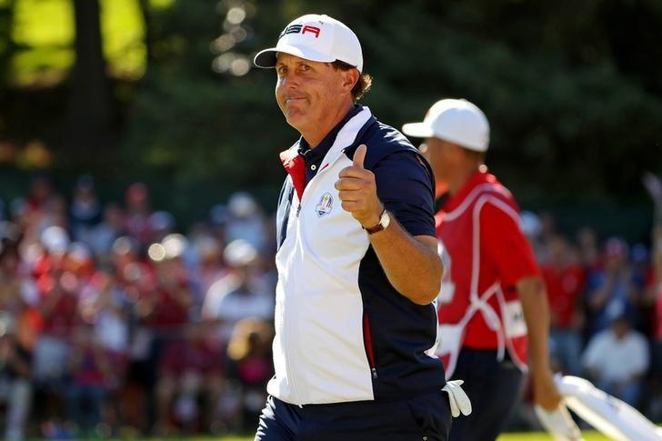 Oct 2, 2016; Chaska, MN, USA;  Phil Mickelson of the United States reacts to the gallery on the 15th green during the single matches in 41st Ryder Cup at Hazeltine National Golf Club. Mandatory Credit: Rob Schumacher-USA TODAY Sports