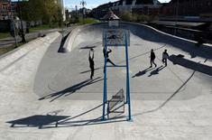 People play basketball at Superkilen park in Copenhagen, Denmark April 22, 2016. Picture taken April 22, 2016.  Aga Khan Award for Architecture/Handout via REUTERS