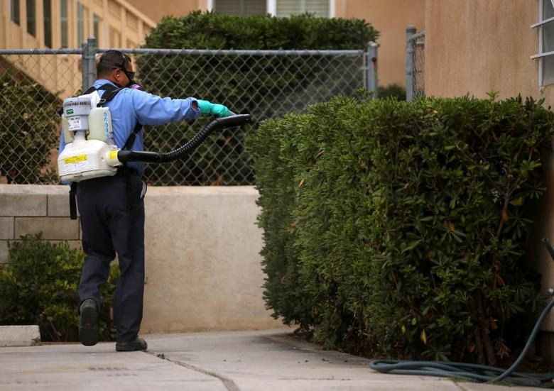A county vector control member hand-sprays a home for adult Aedes mosquitoes after a travel-related case of Zika was confirmed in this neighborhood of San Diego, California, U.S. September 12, 2016. REUTERS/Mike Blake