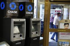 JPMorgan Chase ATMs stand near a door as customers walk past a Duane Reade store in New York, U.S., October 3, 2016. REUTERS/Lucas Jackson