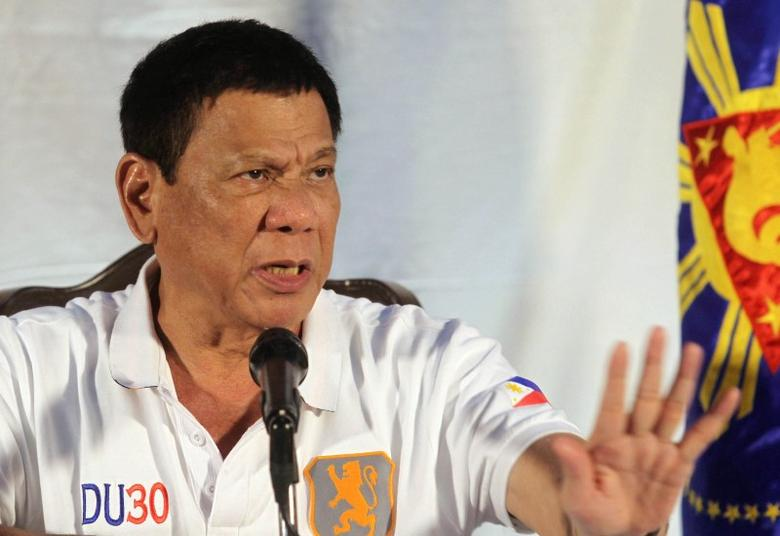 Philippine President Rodrigo Duterte speaks during a news conference in Davao city, southern Philippines August 21, 2016.   REUTERS/Lean Daval Jr/File Photo