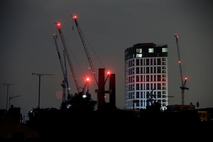 Construction cranes are seen in a residential area in London September 15, 2016.   REUTERS/Kevin Coombs