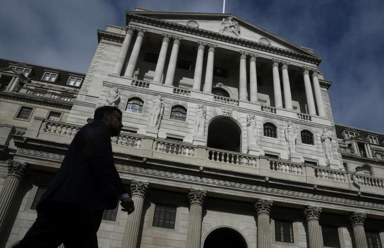 A man walks past the Bank of England in the City of London, in London, Britain September 28, 2016. REUTERS/Toby Melville