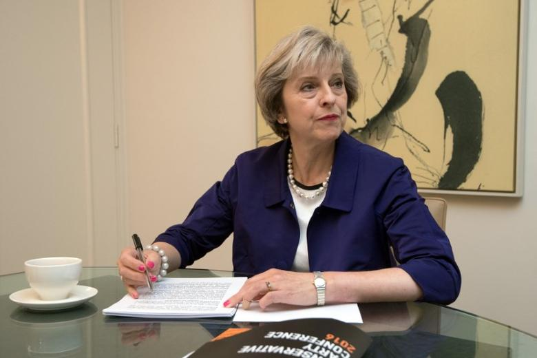 Britain's Prime Minister Theresa May sits in her hotel room as she prepares her conference speech which she will deliver tomorrow to her party's annual conference in Birmingham, Britain, October 4, 2016 REUTERS/Carl Court /Pool