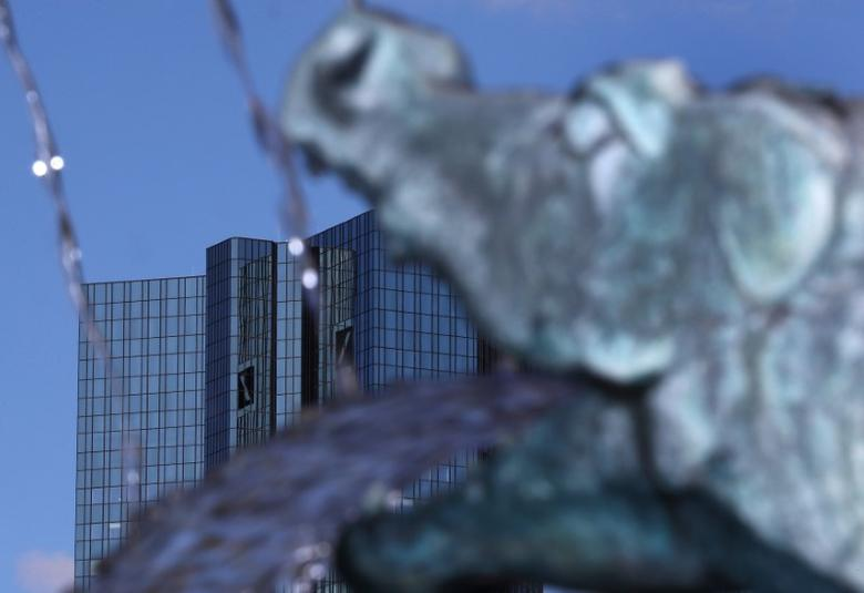A sculpture of a dragon, part of a fountain, is seen next to the headquarters of Germany's Deutsche Bank in Frankfurt, Germany, October 5, 2016.   REUTERS/Kai Pfaffenbach