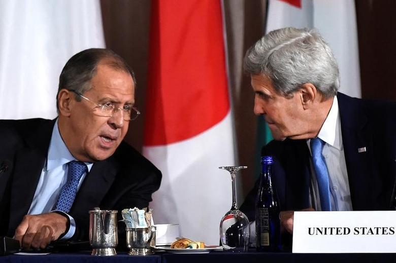 U.S. Secretary of State John Kerry speaks with Russian Foreign Minister Sergei Lavrov during the International Syria Support Group meeting at the Palace Hotel in Manhattan, New York, U.S., September 22, 2016.  REUTERS/Darren Ornitz