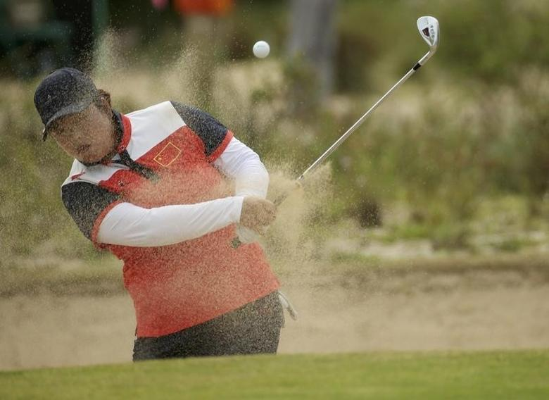 2016 Rio Olympics - Golf - Final - Women's Individual Stroke Play - Olympic Golf Course - Rio de Janeiro, Brazil - 20/08/2016.   Shanshan Feng (CHN) of China hits out of a bunker on the 13th hole during final round women's Olympic golf competition.    REUTERS/Andrew Boyers