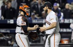 San Francisco Giants starting pitcher Madison Bumgarner (right) and  catcher Buster Posey (left) celebrate the win against the New York Mets in the National League wild card playoff baseball game at Citi Field. Mandatory Credit: Anthony Gruppuso-USA TODAY Sports